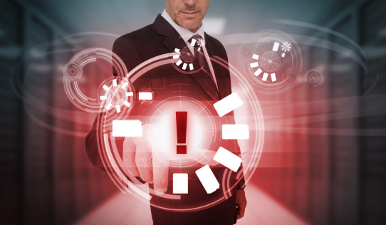 Businessman touching futuristic warning icon interface
